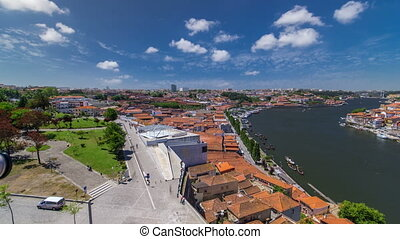View of the historic city of Porto, Portugal with park timelapse. A metro train can be seen on the bridge
