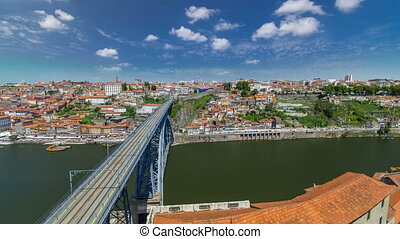 View of the historic city of Porto, Portugal with the Dom Luiz bridge timelapse. A metro train can be seen on the bridge