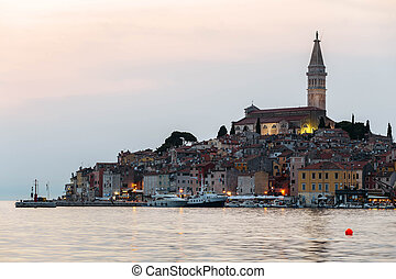 View of the historic part of Rovinj in Croatia during sunset. Above the town rises the Church of St. Euphemia.