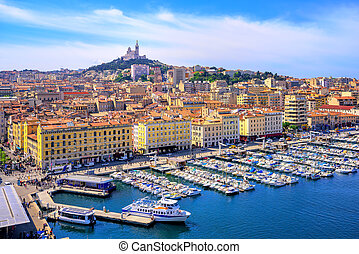 The old Vieux Port and Basilica Notre Dame de la Garde in the historical city center of Marseilles, France