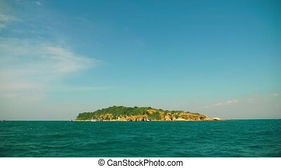 view of the island from the sea. sailing past the island.