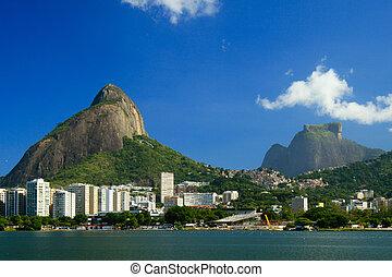View of the Lagoa Rodrigo de Freitas in Rio de Janeiro with the Pedra da Gavea on the background on a beautiful sunny day