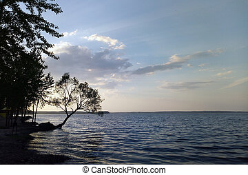 View of the lake and the beautiful sky on a sunny day in summer or spring.