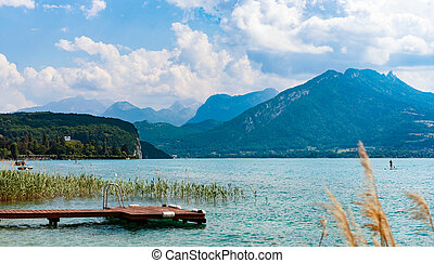 View of the lake Annecy with the mountains in the background