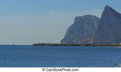 View of the Lighthouse by the Sea near the Rock of Gibraltar. Spain.