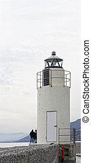 View of the lighthouse of city of Camogli, Genoa Province, Liguria, Mediterranean coast, Italy