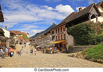 View of the main street in the swiss village Gruyeres, Switzerland on May 08, 2013. The town and region are famous for their Swiss Cheese called Gruyere.