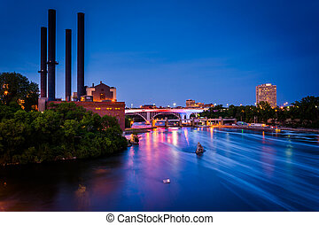 View of the Mississippi River from the Stone Arch Bridge at night in Minneapolis, Minnesota.