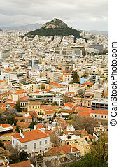 View of the Mount Lycabettus and red roofs in the center of Athens, Greece. Photo taken from Akropolis