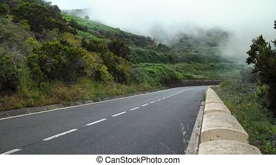 View of the mountain road in the clouds.