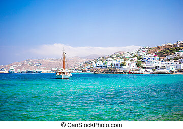 View of the Mykonos town harbor from the above hills in Mykonos, Cyclades, Greece
