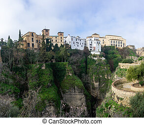 view of the narrow and deep El Tajo Gorge in Ronda in Andalusia
