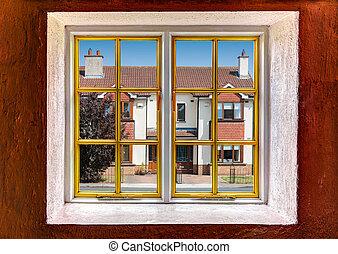 View of the neighborhood through a window