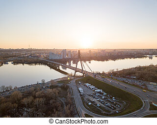 North Bridge with a large parking for cars over the Dnieper...