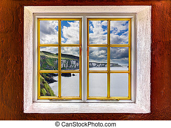 View of the ocean and cliffs through a window