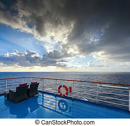 View of the ocean and sky from a cruise deck. The morning ...