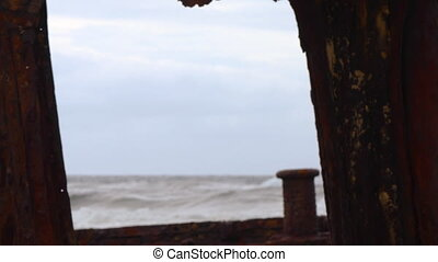 View of the ocean from a rusted ship