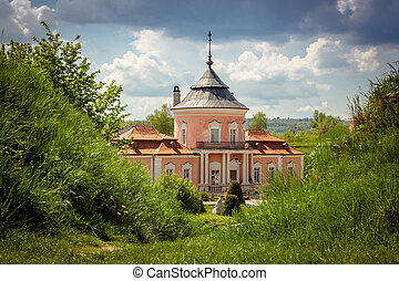 View of the old castle on sunny day against the blue sky in Zolochiv, Lviv region in Ukraine.
