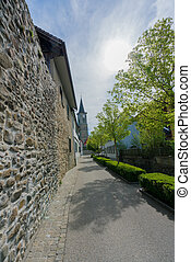 view of the old city wall and church in the Swiss village of Steckborn
