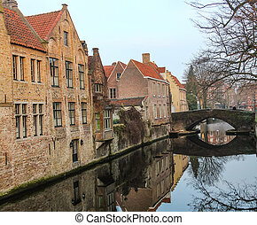 view of the old houses on the embankment of the river in the city of Ghent in Belgium
