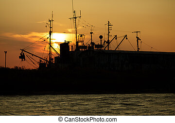 view of the old port at sunset