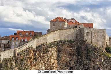 View of the old town and fortification wall in Dubrovnik, Croatia, on a sunny day