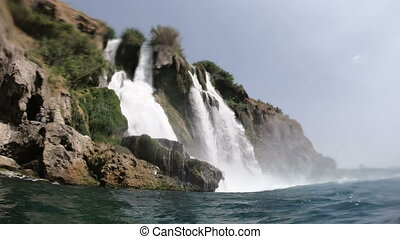 View of the Picturesque Lower Duden Waterfall Falling into the Sea in Antalya, Turkey. Swimming Around
