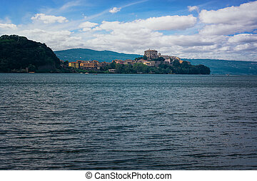 View of the picturesque village of Capodimonte on the coast of Lake Bolsena
