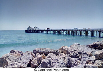 View of the pier on Santa Monica Beach in Southern California, Los Angeles.