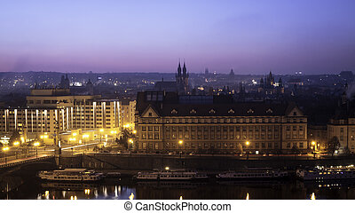 View of the Prague 1 (Old town) at morning daylight with beautiful colour at sky, and Vltava river on foreground.