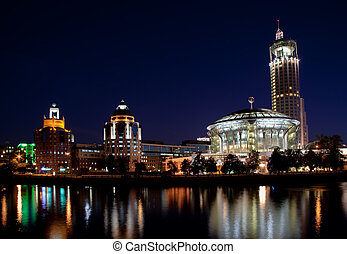 View of the Red Hills Swissotel hotel and Moscow International House of Music over the Moscow-river at night