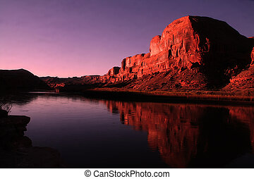 View of the red rock formations in Canyonlands National Park with blue sky?s and reflections on the Colorado River