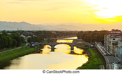 Ponte Santa Trinita at sunset in Florence. - View of the...
