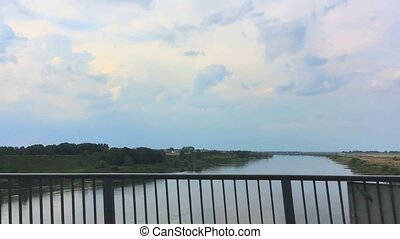 view of the river from a car window when moving on the bridge. Poland, Europe.
