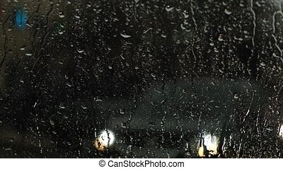 View of the road from the car through the windshield in the rain