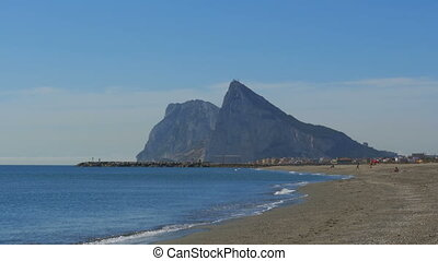 View of the Rock of Gibraltar and the Beach with Sea Waves