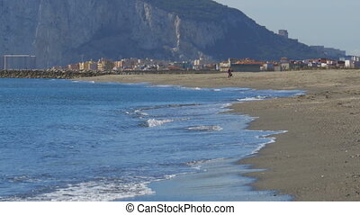 View of the Rock of Gibraltar and the Beach with Sea Waves -...