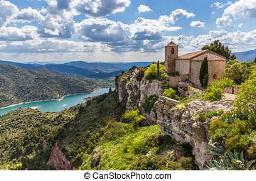 View of the Romanesque church of Santa Maria de Siurana in...