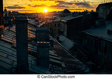 View of the roofs in Sankt Petersburg old town during sunset. Russia.