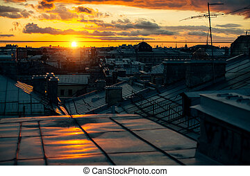 View of the roofs in St. Petersburg old town during sunset.