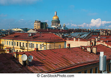 View of the roofs of houses in St. Petersburg, with the Kazan Cathedral in the background.