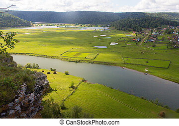 View of the Russian countryside in summer - Horse and cow...