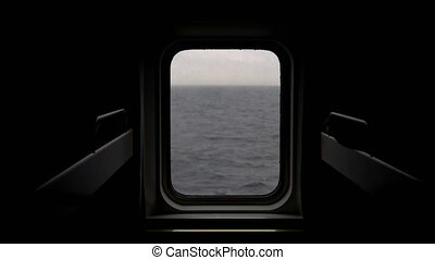 View of the sea from the porthole of the ship.