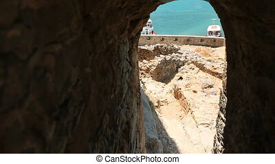 view of the sea through a window in the opposite wall....
