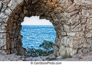 view of the sea through the loophole of the fortress - view...