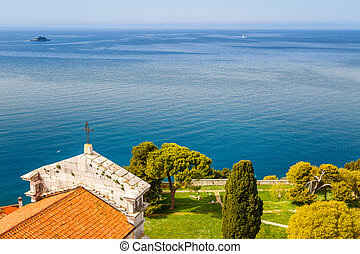 View of the sea with a small island in the distance from a cathedral tower in Rovinj town, Croatia, Europe.