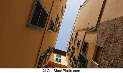View of the sky from the bottom between the buildings from...