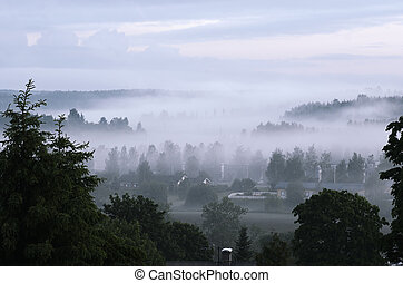 view of the small Finnish town in fog