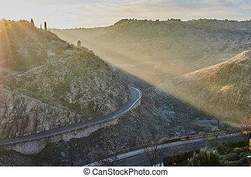 View of the sunrise from the viewpoint of Corralillo de San Miguel to the Tajo river in Toledo, Castilla La Mancha, Spain.