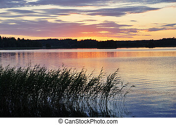 view of the sunset over the lake